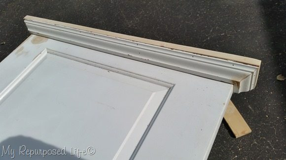 add board and crown molding to bottom of door chalkboard