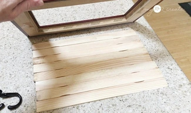 fitting paintsticks for backing on jewelry frame