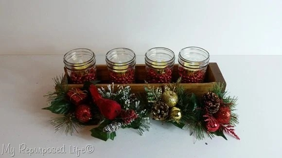 putting together jelly jar centerpiece