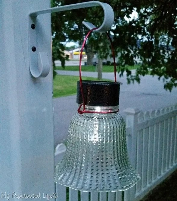 Ceiling fan glass globe solar lights are so easy and inexpensive to make. They are perfect for the patio, special events and weddings. Make some today! #MyRepurposedLife #repurposed #ceiling #fan #globes #solar #lighting via @repurposedlife