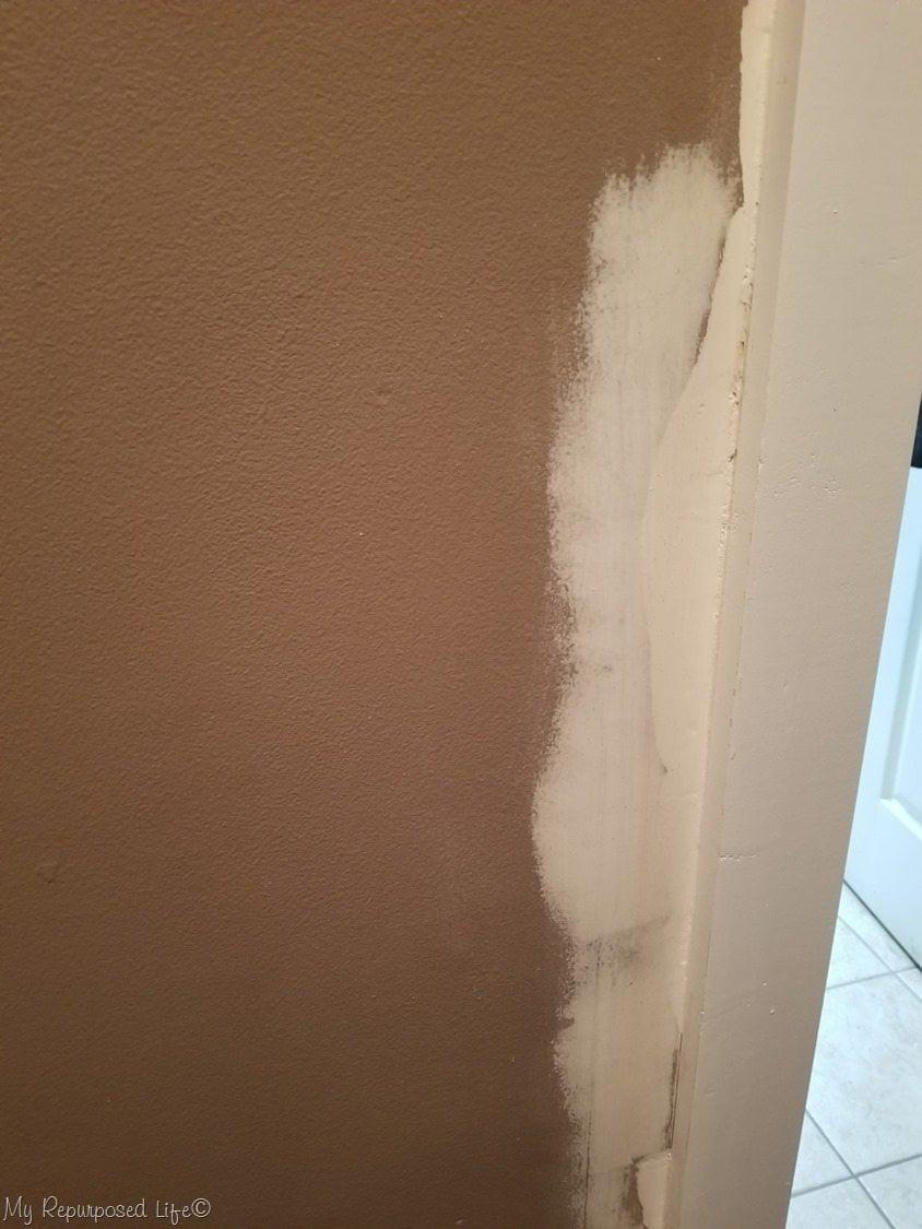 patching broken plaster around door trim