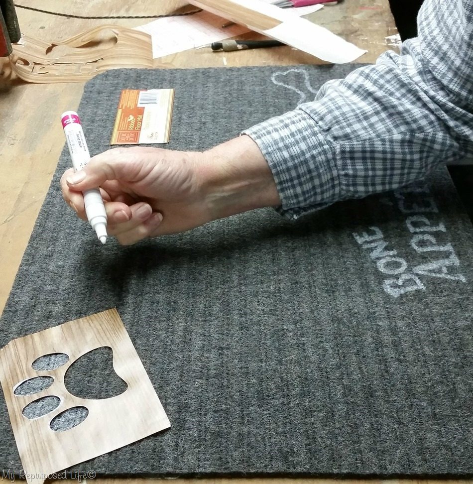 trace paw print stencil dollar store welcome mat dog bowl mat