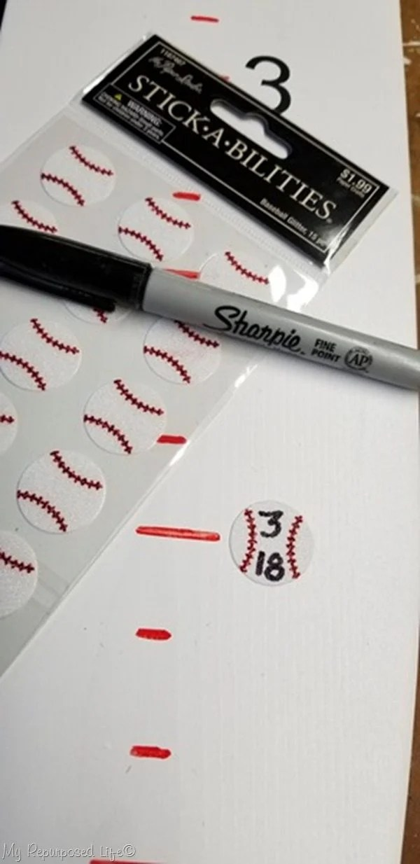 baseball stickers mark height on growth chart