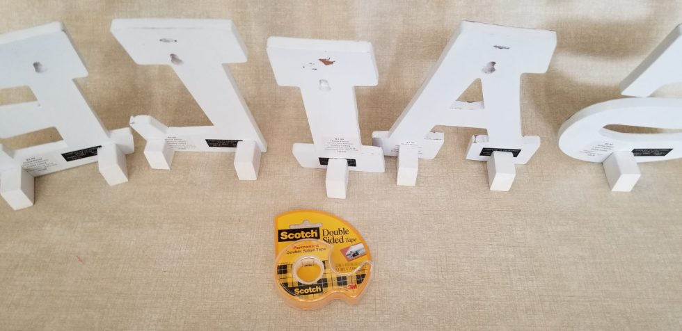 apply double stick tape to easels for temporary display