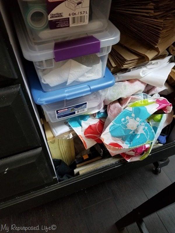 craft station cluttered storage
