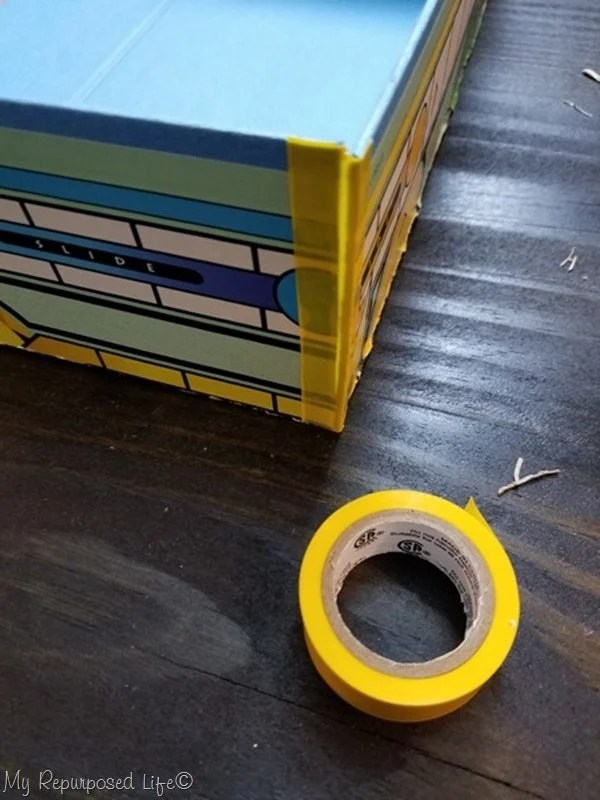 cut electrical tape to size to assemble game board box