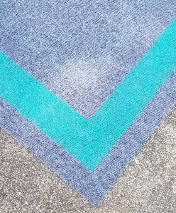 closeup of spray painted border outdoor rug