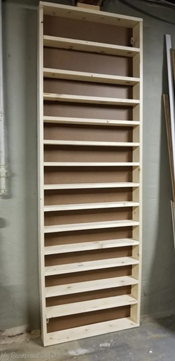floor to ceiling craft paint shelf unit