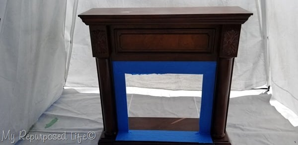 tape off faux fireplace mantel before painting