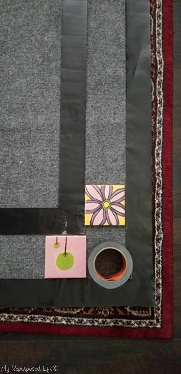 use duct tape to paint a border on outdoor rug