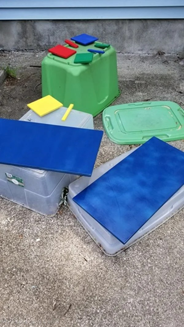 spray paint random wooden pieces for toddler busy board