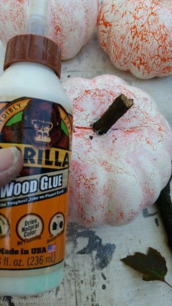 glue wooden branch stem to dollar store pumpkin