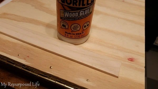 use a paint stick to cover screw points sticking through