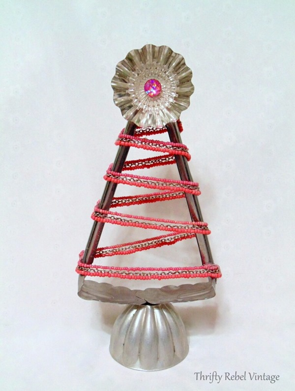 Repurposed-salad-tongs-into-Christmas-tree-with-pink-beaded-necklace-tart-tin-jello-mold-and-light-reflector.