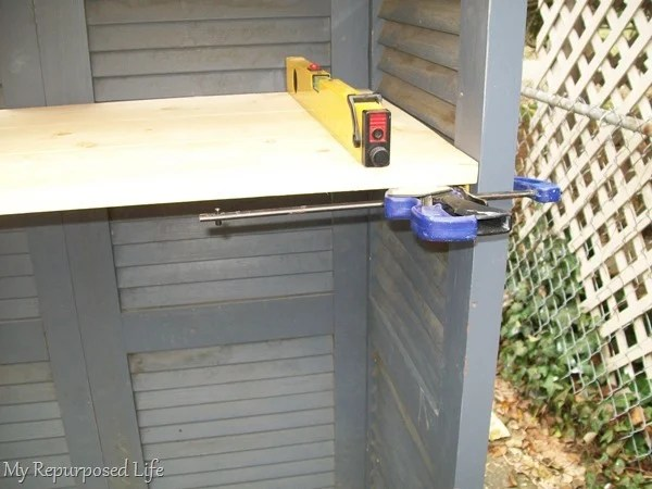 how to install shelves on a shutter bookshelf