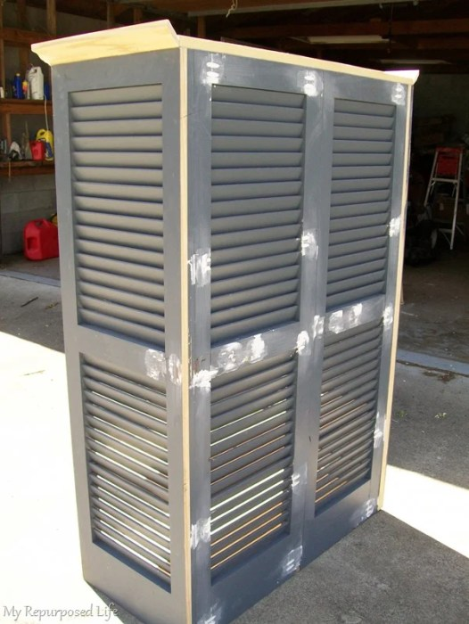 back view of repurposed shutter bookcase