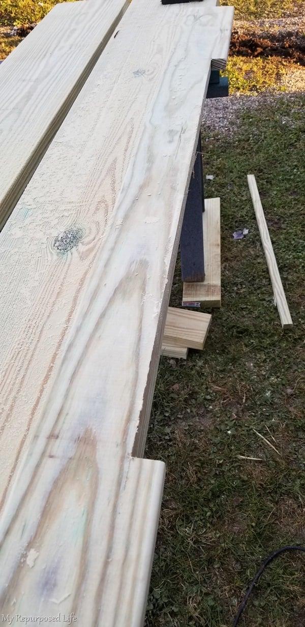 notch last deck board to fit around concrete step
