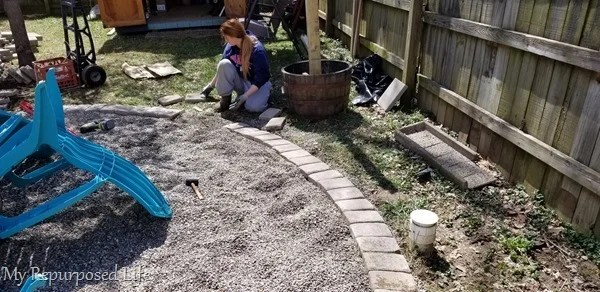 one paver at a time around the fire pit