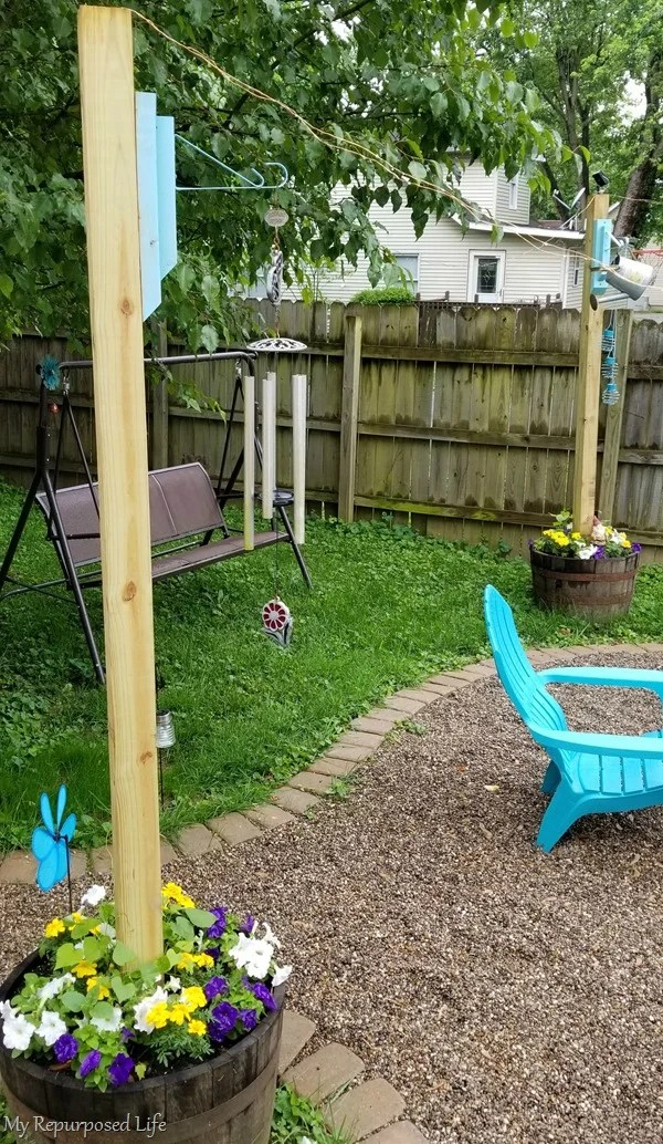 diy wooden brackets to hang wind chimes on 4x4 whiskey barrel planter 4x4 post