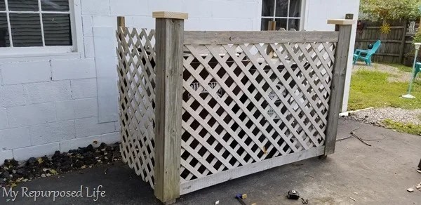 adding finishing touches to garbage can corral