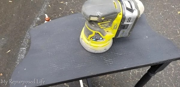 sand table top with orbital sander