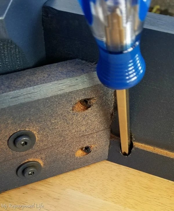 reattach table to base with screwdriver
