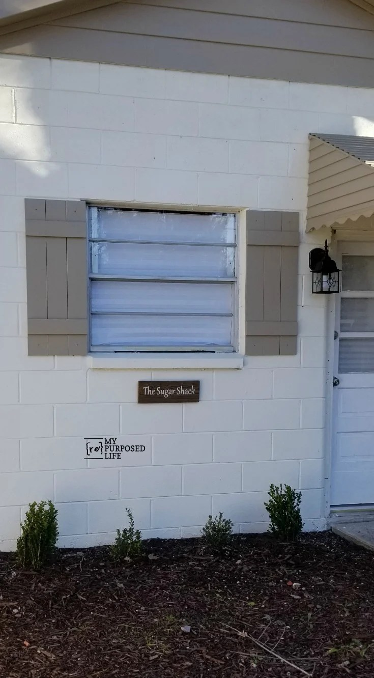 How to assemble and install faux farmhouse shutters on your outbuilding, she- shed or home. Great step by step directions on building and installing shutters in brick or stone. #myrepurposedlife #shutters #farmhouse #diy #sheshed #outbuilding via @repurposedlife