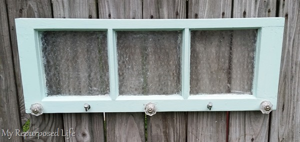 vintage green window used for hanging items