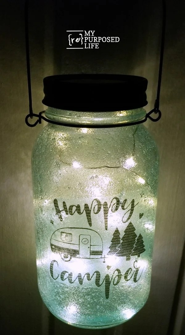 How to make mason jar luminaries with tissue paper, copy paper and more. Add solar lid with twinkle lights and handle, making it a perfect addition to your patio or campsite! #MyRepurposedLife #diy #masonjar #craft #solar via @repurposedlife