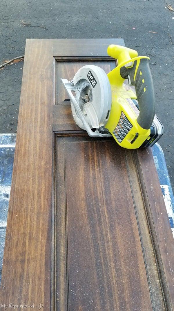 cut narrow door piece with circular saw to make a bench