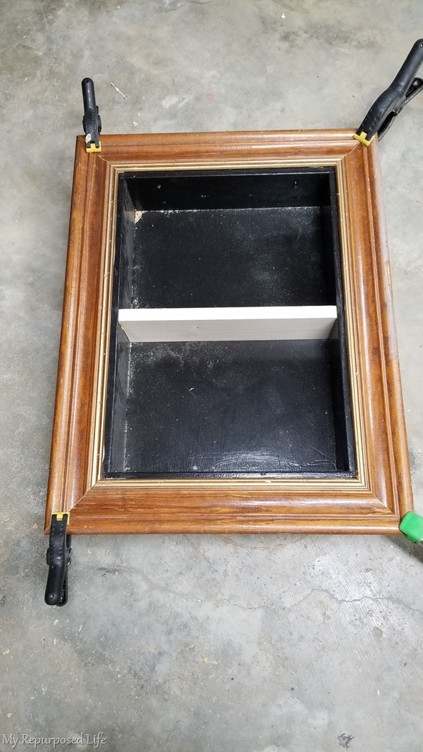 glue and clamp frame around shadow box