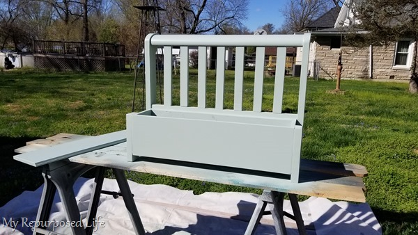 paint toy box bench green with paint sprayer