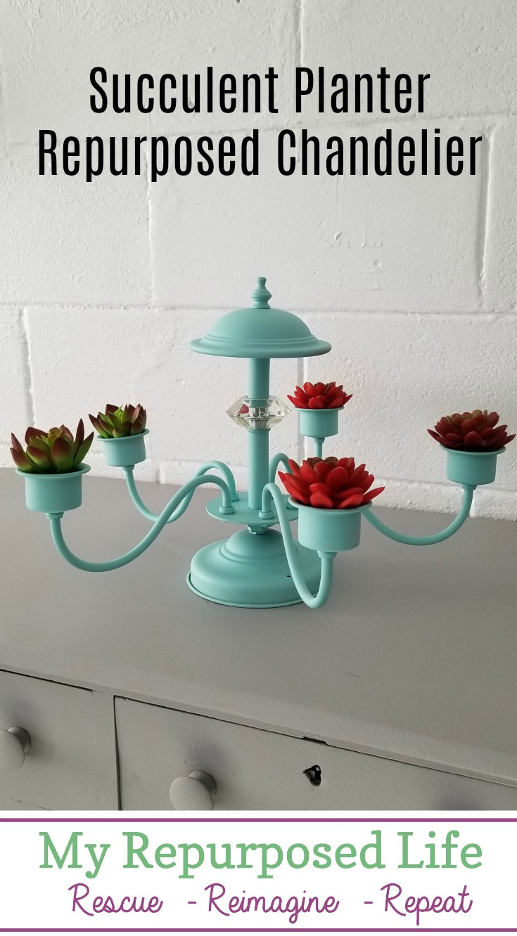 How to make a repurposed chandelier succulent planter that is interchangeable from hanging to setting on a table as a centerpiece. You could easily change this out with candles or potted plants. Spray painting a brass chandelier really gives you so many options to match your decor. #MyRepurposedLife #repurposed #chandelier #succulent #planter via @repurposedlife
