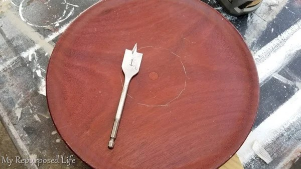 paddle bit on wooden platter