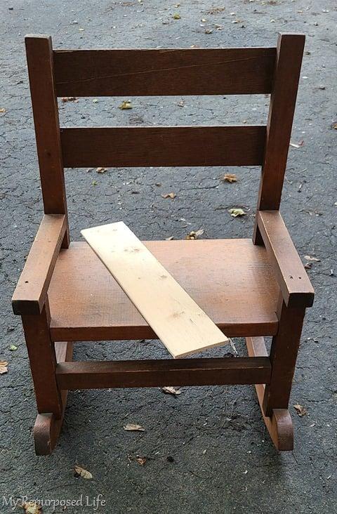 broken dolls rocking chair