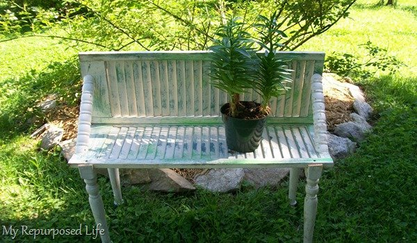 repurposed shutter bench for plants
