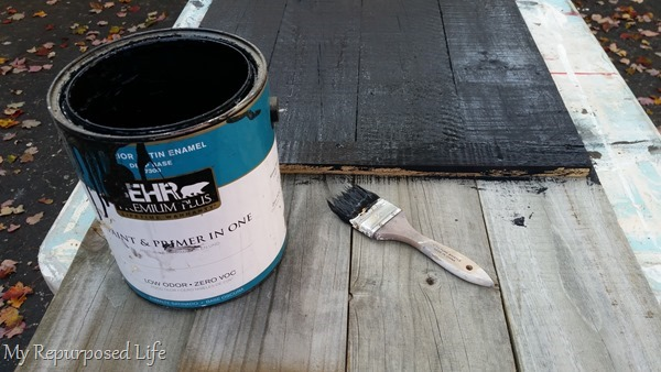 paint sign with black base coat