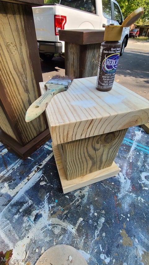 paint base coat of burnt umber on pedestals