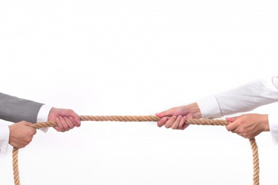 Two men pulling on a rope. In the article Advice for Event Producers.