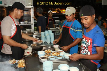 workers preparing Bak Kut Teh
