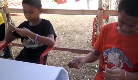 kids trying Binsulong
