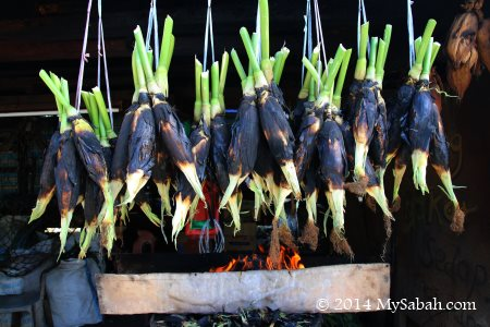 hanging grilled corn