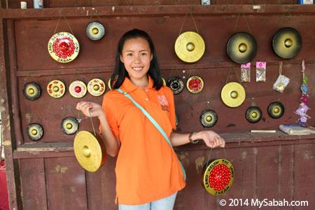 girl holding gong handicraft