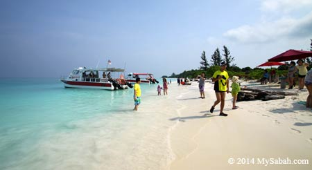 tourists at the seaside of Mengalum Island
