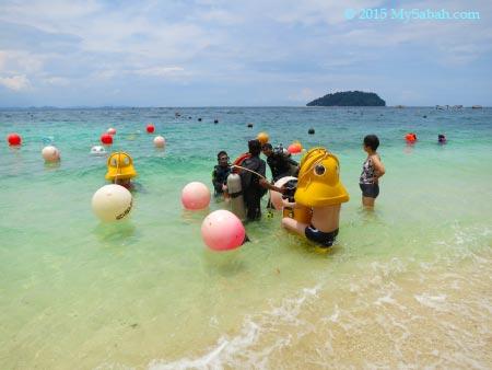 tourists trying Scuba-doo