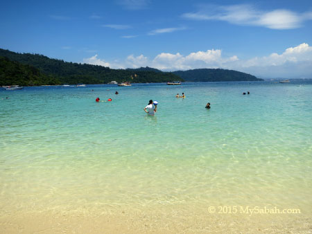 tourists in the sea of Sapi Island