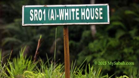 road sign to Whitehouse