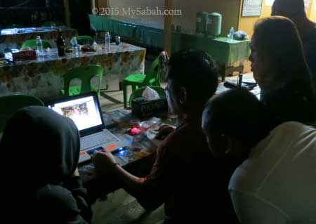 looking at photos from camera traps