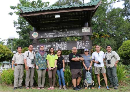 group photo at gate of Deramakot forest reserve