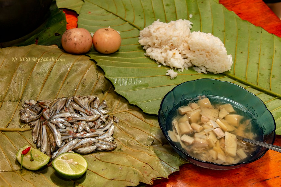 Linuput rempis (fishes wrapped in multiple layers of leaves and cooked), tree heart soup and rice